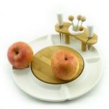 Яблоко на блюде Стоковые Изображения RF