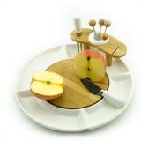 Яблоко на блюде Стоковые Фотографии RF