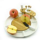 Яблоко на блюде Стоковые Фото