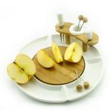 Яблоко на блюде Стоковое Фото