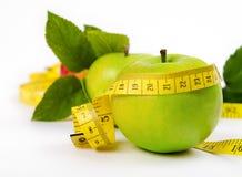 Яблоко с листьями и лентой Стоковое Изображение