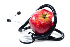 Яблоко день держит доктора отсутствующей стоковое изображение