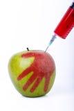 Яблоко с шприцем Стоковое фото RF