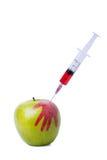 Яблоко с шприцем Стоковые Фотографии RF