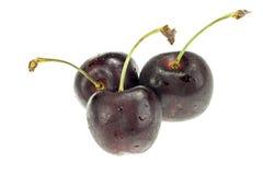 3 ягоды вишни изолированной на белой предпосылке Стоковая Фотография