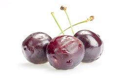 3 ягоды вишни изолированной на белой предпосылке Стоковое Изображение RF