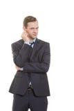 Язык жестов человек в белизне изолированной деловым костюмом Стоковое Изображение