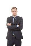 Язык жестов человек в белизне изолированной деловым костюмом Стоковые Фотографии RF