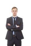 Язык жестов человек в белизне изолированной деловым костюмом Стоковое Изображение RF