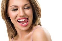 Язык чувственной женщины сдерживая стоковое изображение rf