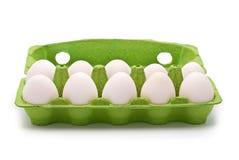 10 яичек в зеленом контейнере Стоковое фото RF