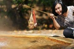 Яичка женщины кипя Стоковое фото RF