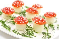 яичка сделали грибами томаты Стоковые Фото