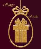 Яичко и подарочная коробка отрезка пасхи золотые Стоковые Фото