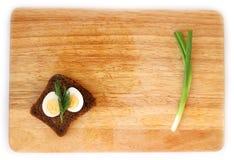 Яичко триперсток и wholegrain положение квартиры хлеба Стоковая Фотография