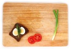 Яичко триперсток и wholegrain положение квартиры хлеба Стоковая Фотография RF
