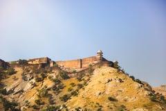 Янтарный форт с золотыми светом солнца и горой, Раджастханом, Индией Стоковые Фотографии RF