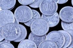 Японец одна иена чеканит на черной предпосылке Стоковая Фотография