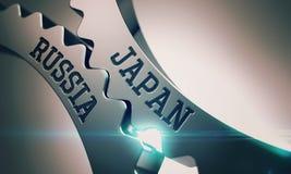 Япония Россия - надпись на механизме Cogwheels металла Стоковое фото RF