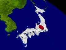 Япония с флагом на земле Стоковое Изображение RF