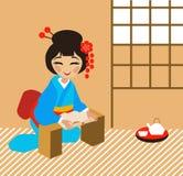 Японская девушка читает книгу Стоковая Фотография
