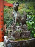 Японская каменная статуя Стоковое Изображение