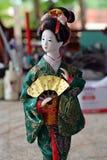 Японская кукла в платье КИМОНО стоковая фотография rf