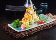 Японская кухня суши на предпосылке Стоковые Фотографии RF