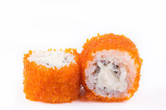 Японская кухня, установленные суши: суши и крены суш в икре с сыром на белой предпосылке Стоковые Фото
