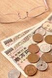 Японские иены с eyeglasses Стоковая Фотография