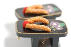 японские миниатюрные сандалии Стоковые Изображения