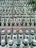 Японские скульптуры jizo в виске Hase-Dera Стоковые Фото