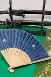 Японский складывая вентилятор и японская шпага Стоковые Изображения RF