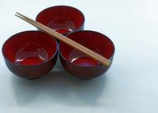 3 японских шара лака и деревянных палочки перед a Стоковое Изображение