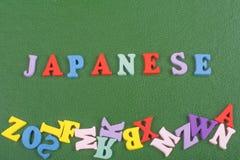 ЯПОНСКОЕ слово на зеленой предпосылке составленной от писем красочного блока алфавита abc деревянных, космосе экземпляра для текс Стоковые Изображения RF