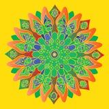 Яркая ая-зелен и оранжевая мандала на желтой предпосылке Стоковая Фотография