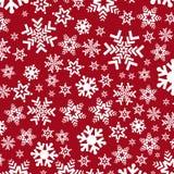 Яркая красная предпосылка с снежинками Стоковая Фотография
