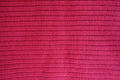 Яркая красная ткань knit нервюры стоковая фотография