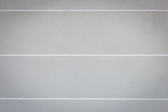 Яркая серая стена цемента с белыми текстурой и предпосылкой нашивки Стоковая Фотография