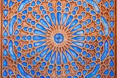 Яркая симметричная картина круга в оранжевом и голубом Стоковое фото RF