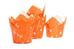 Яркие пестротканые держатели торта бумажного стаканчика в куче Стоковая Фотография RF
