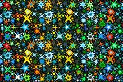Яркие пестротканые звезды на черноте стоковые фото