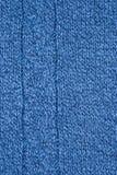 Яркие связанные обои текстуры шарфа Стоковые Фото