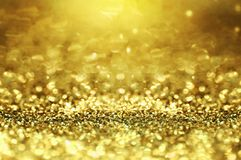 Яркий блеск золота и абстрактная предпосылка bokhe рождества стоковая фотография