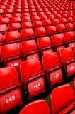 яркий красный цвет усаживает стадион Стоковые Изображения