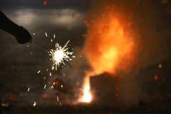 Яркий фейерверк бенгальского огня в руке Стоковые Фото