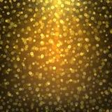 Яркое bokeh предпосылки конспекта золота Стоковая Фотография