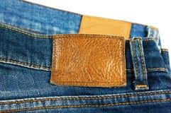Ярлык кожи коричневого цвета крупного плана джинсов Стоковое Изображение