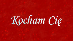 Я тебя люблю отправьте СМС в польском Kocham Cie на красной предпосылке Стоковая Фотография RF