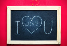 Я тебя люблю рукописный на доске Стоковое фото RF